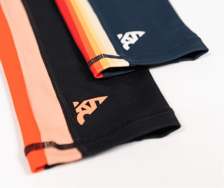 Kit Change leggings with the signature side stripes